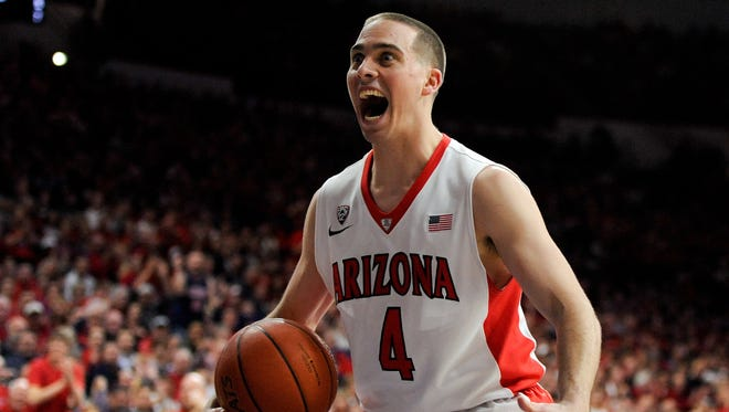 T.J. McConnell (4) orchestrates Arizona's offense at the point and pesters opponents as a defensive ballhawk.