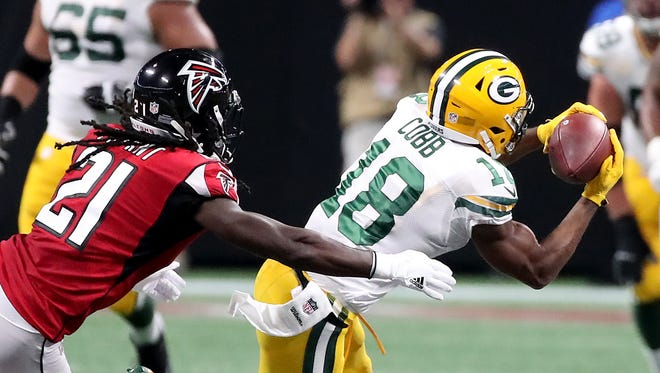 Green Bay Packers wide receiver Randall Cobb (18) makes a catch over the middle against the Atlanta Falcons cornerback Desmond Trufant (21) Sunday, September 17, 2017 at Mercedes-Benz Stadium in Atlanta, Ga.
