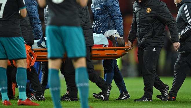 Manchester United's Romelu Lukaku is taken off on a stretcher.