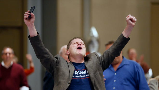 Trump supporter Grant Bynum raises his hands after hearing the news Donald Trump won Ohio in the Presidential election during a Dallas County Republican watch party at the Westin Dallas Park Central hotel in Dallas, Texas, late on Tuesday, Nov. 8, 2016.  (Jae S. Lee/The Dallas Morning News via AP)