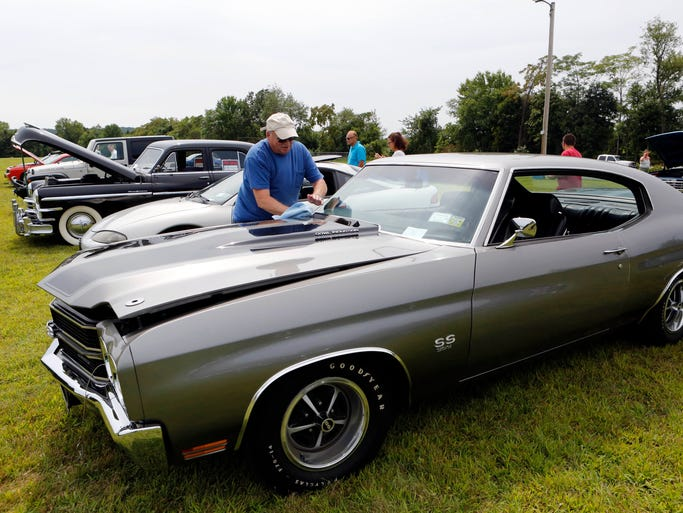 Michael Delisio of West Haverstraw looks after his 1970 Chevelle SS at the 2nd annual Anthony Amoros car show, Aug. 16, 2014 at Marian Shrine in Stony Point. Amoros of Pomona, a 2012 North Rockland High School graduate, died Jan. 29, 2013, after he was taken to Nyack Hospital for severe facial and head injuries caused by a crash the day before on Thiells-Mount Ivy Road in Thiells. Proceeds from the event will go towards the Anthony Amoros Memorial Scholarship at Rockland Community College.