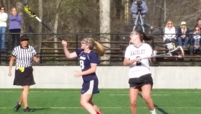 Rye Country Day's Taylor Regan (left) wins a draw control against Hackley's Sammy Mueller during a girls lacrosse game at the Hackley School on Monday, April 25th, 2016. Hackley won 14-8.