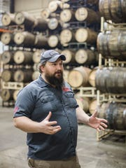 John Stewart, director of brewing operations, speaks with Detroit Free Press Reporter, Robert Allen, about the cellar at Perrin Brewing Company in Comstock Park, Mich. on Thursday, Feb. 23, 2017.