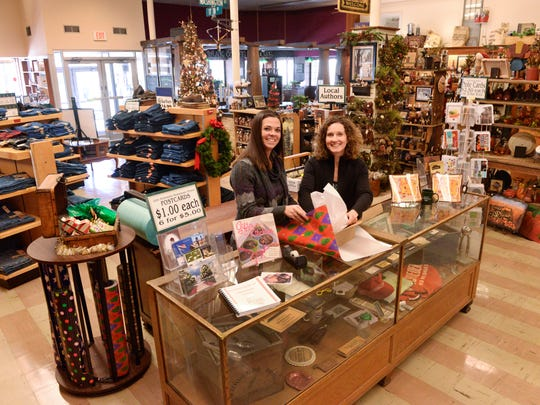 Theresa Kronforst, left, and AJ Ashenbrenner offer a relaxed atmosphere for shopping at Schroeder's Department Store in Two Rivers.