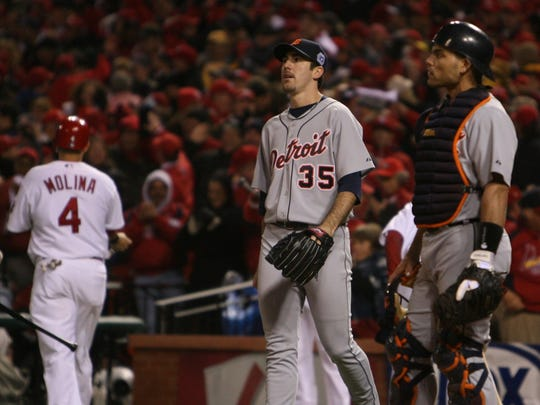 Detroit Tigers' Justin Verlander and Ivan Rodriguez react after Verlander  made a throwing error that allowed the St. Louis Cardinals' Yadier Molina to score in the 4th  inning of Game 5 of the 2006 World Series on Friday, Oct. 27, 2006 in St. Louis.