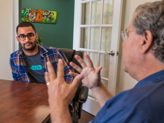 Christian Pelaez-Espinosa, and David Wilkins talk at Wilkins' office in Tallahassee