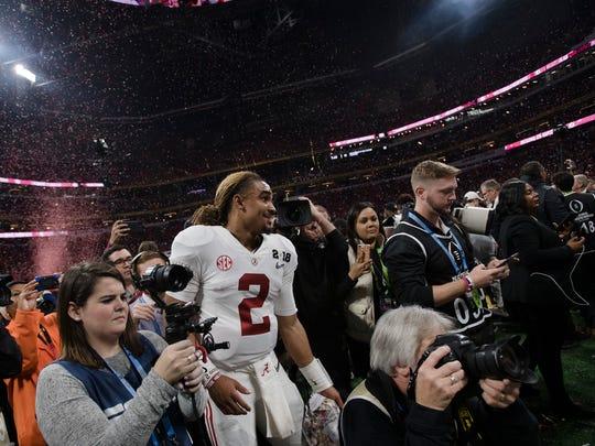 Alabama quarterback Jalen Hurts (2) walks through a crowd after the NCAA National Championship football game between Alabama and Georgia on Monday, Jan. 8, 2018, in Atlanta, Ga. Alabama defeated Georgia in overtime 26-23.