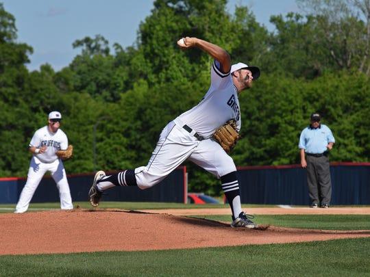 North DeSoto's winning pitcher Hunter Gaston throws