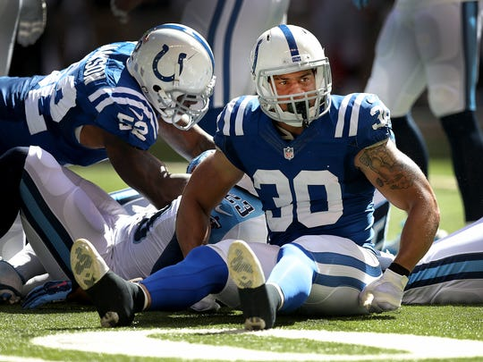 Indianapolis Colts LaRon Landry sits on the field after making a tackle on Tennesse Titans Shonn Greene. The Indianapolis Colts played the Tennessee Titans Sunday. September 28, 2014, afternoon at Lucas Oil Stadium.