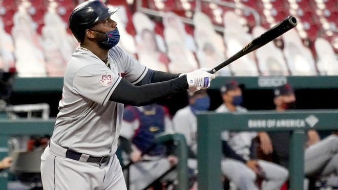 Cleveland Indians' Franmil Reyes watches his three-run home run during the first inning of a baseball game against the St. Louis Cardinals Friday, Aug. 28, 2020, in St. Louis.