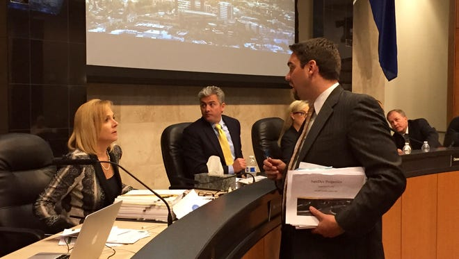 Lobbyist Garrett Gordon talks to Reno City Councilwoman Neoma Jardon during a break at a Council meeting in 2015.