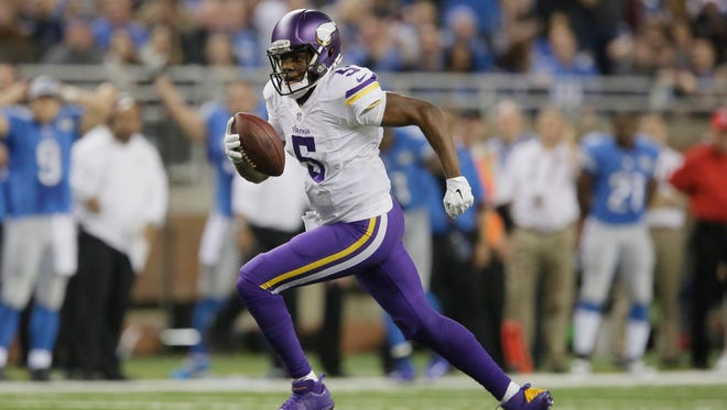 Minnesota Vikings quarterback Teddy Bridgewater (5) scrambles during the second half of an NFL football game against the Detroit Lions at Ford Field in Detroit, Sunday, Dec. 14, 2014. (AP Photo/Duane Burleson)