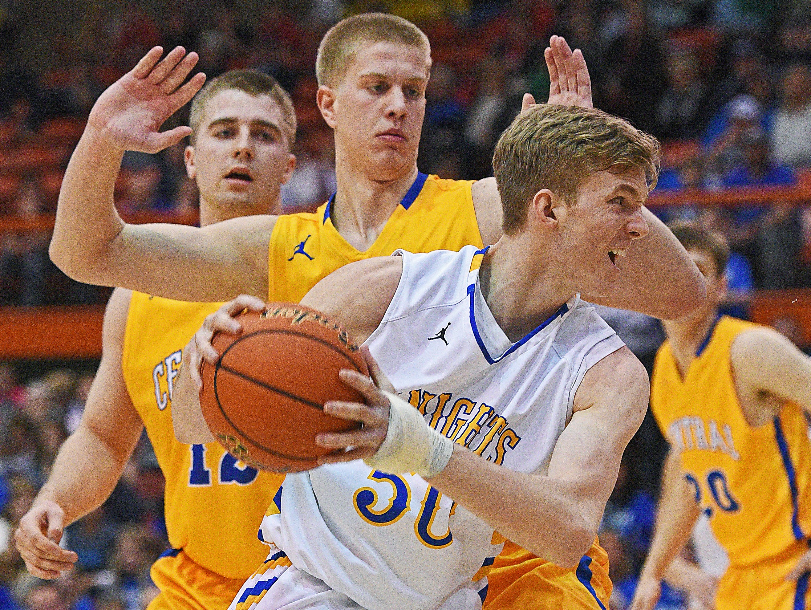 O'Gorman's JP Costello (50) drives to the basket past Aberdeen Central's Cole Bergan (40) during the 2017 SDHSAA Class AA State Boys Basketball championship game Saturday, March 18, 2017, at Rushmore Plaza Civic Center in Rapid City.