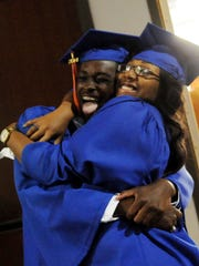 Warren Williams and Sha'Torie Baylor share a hug moments before the Southwood High School Commencement Exercises Wednesday evening.