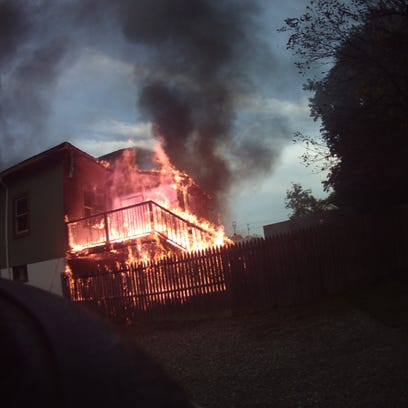 A Town of Poughkeepsie house caught fire Thursday evening,