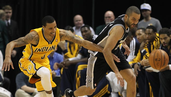 Indiana Pacers guard George Hill (3) battles for the ball with San Antonio Spurs guard Tony Parker (9) during the first quarter at Bankers Life Fieldhouse.