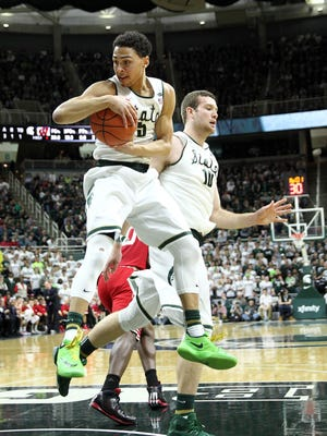 Michigan State guard Bryn Forbes (5) grabs a rebound during the first half of a game against Wisconsin at Jack Breslin Student Events Center Thursday.