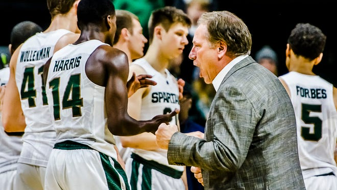 MSU Men's Basketball Head Coach Tom Izzo cheers after encourgaring those attending the Spartans' game with Binghamton to support the MSU football team in their quest to win the Big 10 title Saturday December 5, 2015 in East Lansing.