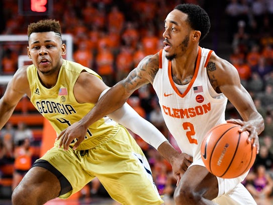 Clemson guard Marcquise Reed (2) attempts to advance