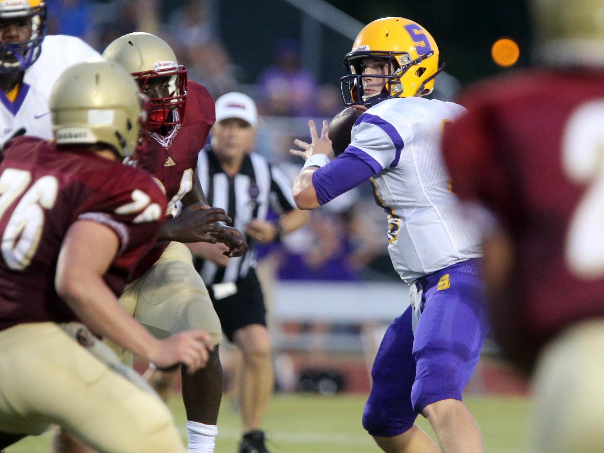 Smyrna's John Turner feels the pressure from Riverdale as they move in while Turner looks for a player to throw to during the second Jamboree game Friday, Aug. 14, 2015, at Stewarts Creek.