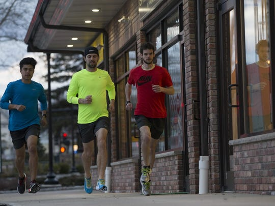 From left, Seton Hall cross country runner Bryant Cordova, store manager Joe Jacobs, and Kyle Brogan of Chatham go for a run.