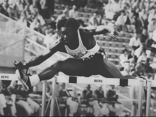 Rodney Milburn stretches over a hurdle in a preliminary race at the 1972 Olympic Games in Munich, en route to winning the gold medal in the event. Milburn, inducted to the Louisiana Sports Hall of Fame in 1988, set several world records in hurdles events as part of the J.S. Clark track team.