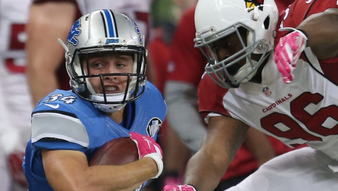 Detroit Lions running back Zach Zenner is tackled by the Arizona Cardinals on Oct. 11, 2015, at Ford Field in Detroit.