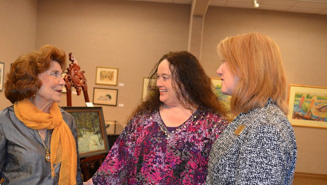 Iris Easterling, left, former curator of the Sarah Ellen Gillespie Museum of Art at William Carey University, speaks with Jeanna Graves, administrative assistant for the Department of Theatre and Communication, and Pam Shearer, the current curator of the Gillespie Museum, at the opening reception for the Katrina Restoration Exhibit at WCU's Hattiesburg campus on November 11. The exhibit features artwork from the Gillespie Collection that was restored following the disastrous 2005 hurricane. The Collection is considered the most comprehensive and extensive collection of art executed by Mississippians during the twentieth century with over 600 works.
