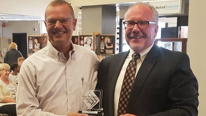Pat Botts (left) is presented with the David Sursa Leadership Award by Jeffrey R. Lang, chairman of the Community Foundation of Muncie and Delaware County Board.