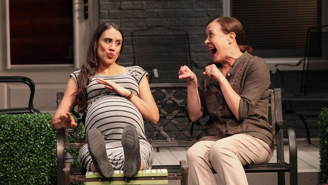 """Virginia Butley (Karen Ziemba, right) attempts to sway new neighbor Tania Del Valle (Sabina Zuniga Varela, left) to her point of view in the Playhouse in the Park's world premiere of Karen Zacarías' """"Native Gardens."""" The show runs through Feb. 21 in Playhouse's Marx Theatre."""