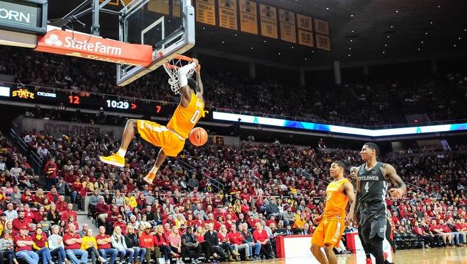 Vols guard Jordan Bone (0) dunks against guard James Daniel III (3) and Iowa State on Saturday.