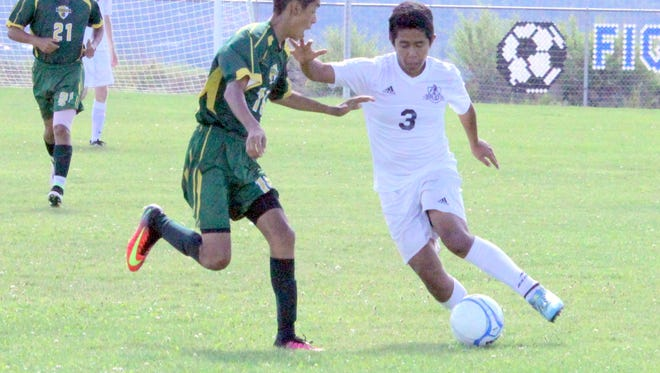 Silver's Marco Narvaez tries to get past a Mayfield defender during action Tuesday at the Ben Altamirano Sports Complex. Narvaez tallied shot shots on goal during the 2-0 loss.