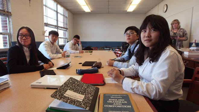 Morris Catholic international students from China take part in a listening lab during ESL freshman class.