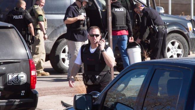 The Cedar City Police Department investigates a double homicide on Feb. 16, 2013.