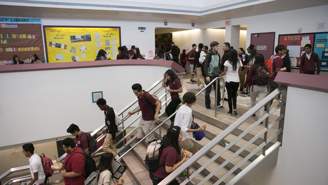 High school students walk between classes at ASU Preparatory Academy in Phoenix on May 26, 2015.