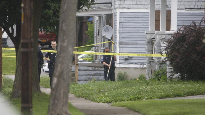 Rochester police investigate on Sterling Street where a man was found shot in the upper torso with injuries considered life threatening on June 11.