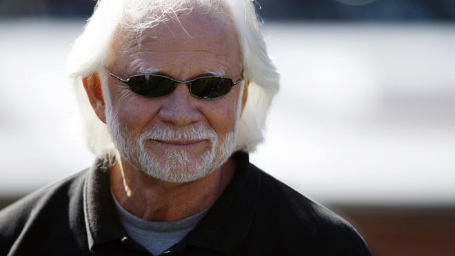 FILE - In this Sunday, Oct. 25, 2009 file photo, former Oakland Raiders quarterback Ken Stabler watches before an NFL football game between the New York Jets and the Oakland Raiders in Oakland, Calif. Stabler, who led the Raiders to a Super Bowl victory and was the NFL's Most Valuable Player in 1974, has died as a result of complications from colon cancer. He was 69. His family announced his death on Stabler's Facebook page on Thursday, July 9, 2015. (AP Photo/Ben Margot, File)