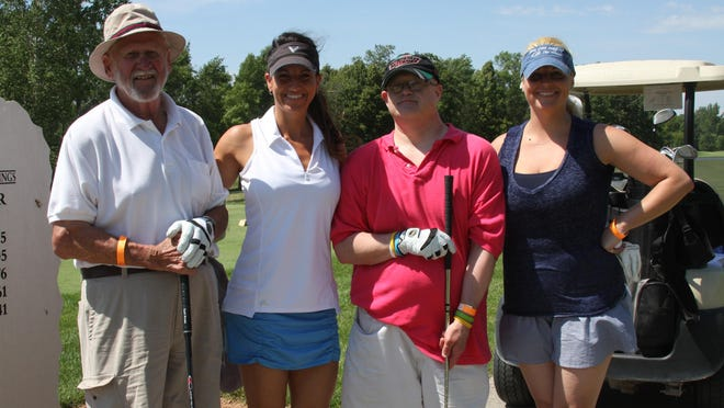 From left, Wayne Schmidt, Kim Glaskey, Tom Schmidt and Kelly Burkley ready to tee off at the Arc of Fond du Lac's 2015 golf outing.