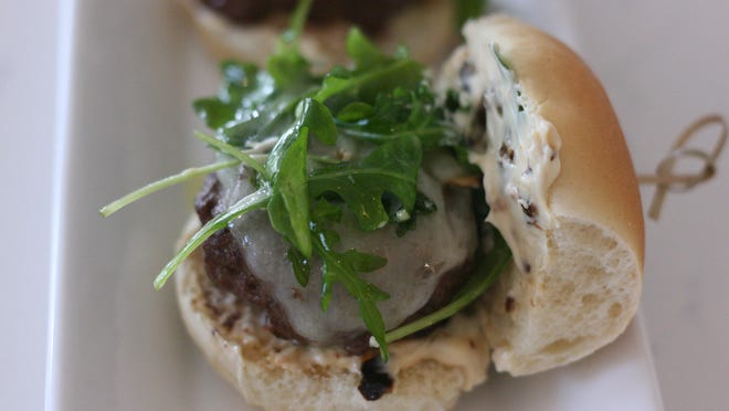 Summertime Sliders with sun-dried tomato mayo and lightly-dressed arugula is a wonderful dinner choice for a warm evening.