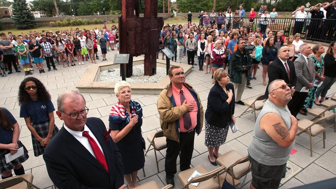 Hearts covered during the National Anthem at the Borough of Morris Plains 9/11 remembrance ceremony. September 11, 2015, Morris Plains, NJ.
