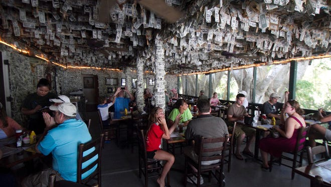 "The Cabbage Key bar, also known as the ""bar with the money on the walls,"" has been serving drinks to boaters for more than 60 years."