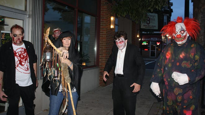 Wanda Kay surrounds herself with zombies for her St. Creep Haunted Walking Tour including James Gullett, Tracey Garnett and Robert Grubbs in a demon clown outfit.