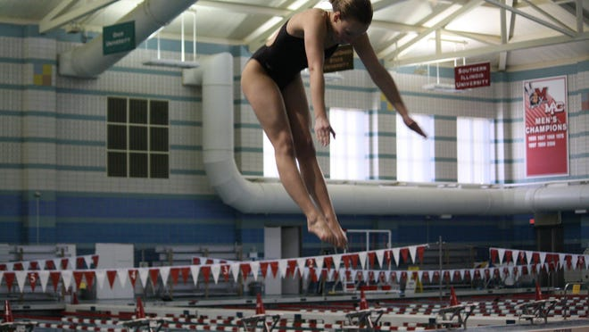 Elizabeth Cron of Oak Hills, shown in the district meet last February, was voted Enquirer Preps Ohio Athlete of the Week.