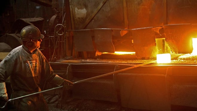 In the 2010 photo at Milwaukee Forge, Rocky Herman takes a hot billet of steel out of the gas furnace and moves it down the line to the hammer operators, who will use their massive 4,000-pound hammers to forge it into the shape needed.