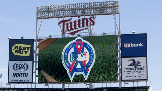 The scoreboard at Target Field displays a Sept. 11 message before the Sept. 11 game between the Minnesota Twins and the Cleveland Indians in Minneapolis.