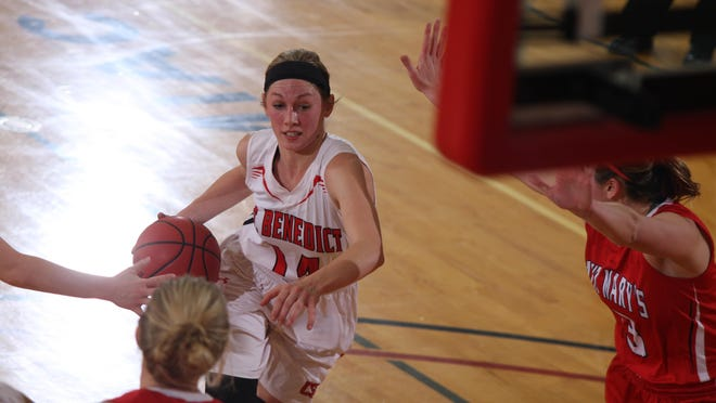 St. Benedict junior Chelsey Guetter drives with the basketball during her team's game against St. Mary's Saturday afternoon at Claire Lynch Hall. Guetter finished with 17 to lead her team in a 47-45 victory.