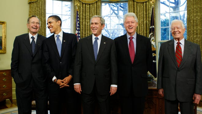 """In this Jan. 7, 2009, file photo, then-President-elect Barack Obama is welcomed by then-President George W. Bush for a meeting at the White House in Washington, Wednesday, Jan. 7, 2009, with former presidents, from left, George H.W. Bush, Bill Clinton and Jimmy Carter. The 5 living former U.S. presidents are creating the """"One America Appeal"""" to raise money for storm recovery as Texas and Louisiana regroup from Harvey and Florida braces for Hurricane Irma. Credit: AP Photo/J. Scott Applewhite"""