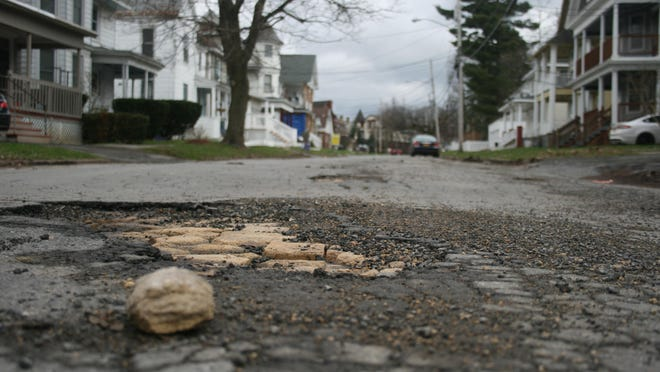 A view of damage to the surface of Shaw Street, east of Sunset Avenue in Utica, in April 2020. The Utica Common Council is reviewing a possible reduction in spending on street repairs in 2021 due to the coronavirus pandemic.