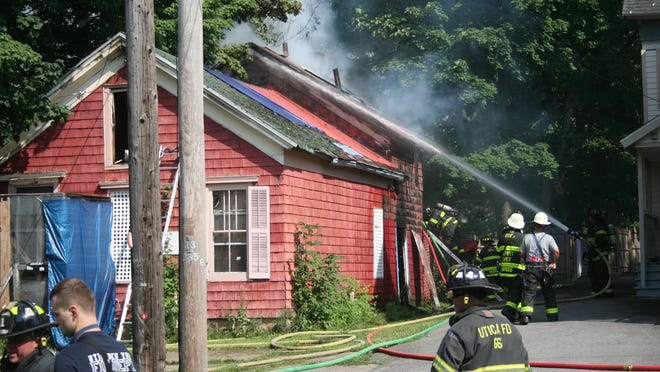 Utica firefighters battle a house fire at 1503 Oneida St. on Monday, Aug. 10, 2020.