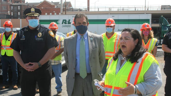 In this July 30 file photo, State Department of Transportation Commissioner Marie Therese Dominguez speaks about Operation Hardhat, a statewide initiative using disguised police to catch traffic violations in road construction zones, during a news conference in the Utica Observer-Dispatch parking lot.